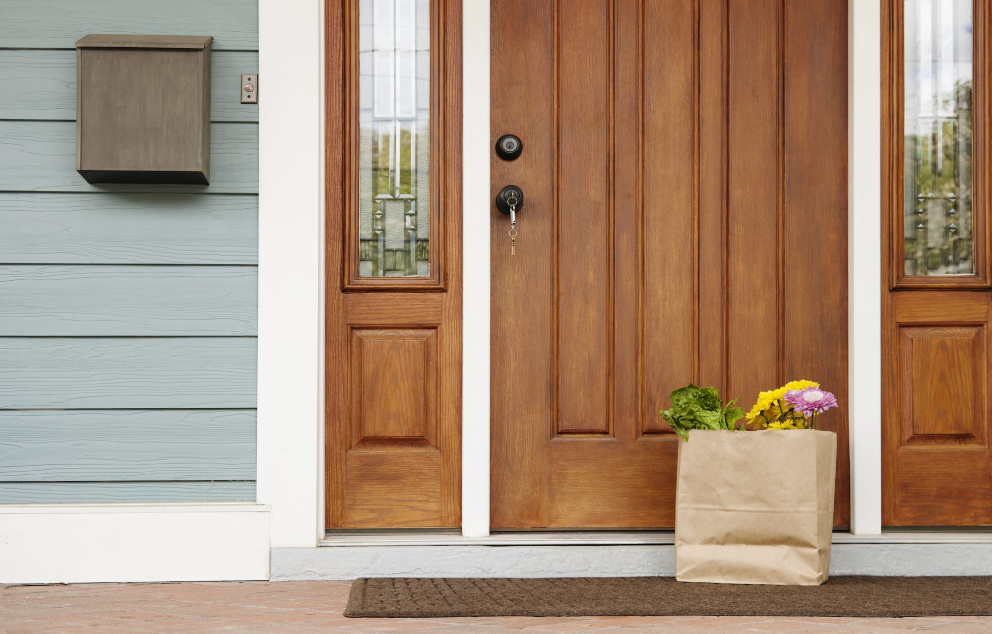 Wooden front door and grocery bag