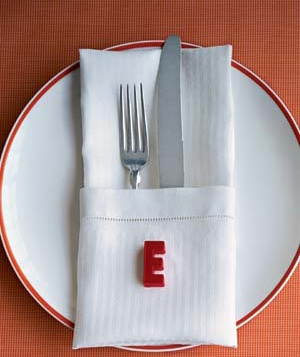 A table place setting with alphabet magnet accent