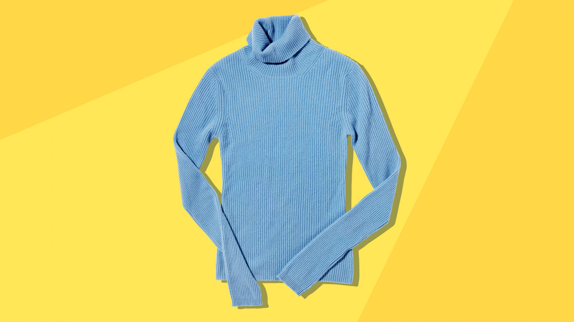 blue cashmere sweater on yellow background: how to care for cashmere