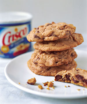 Container of Crisco and plate of cookies