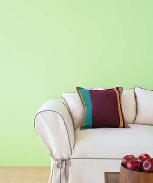 Sofa with multi-colored pillow and slipcover