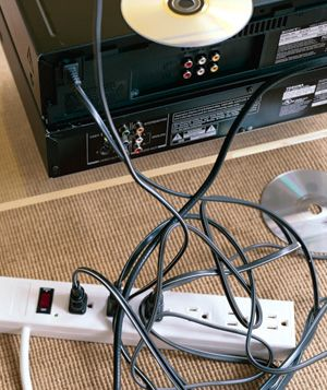 Cables plugged into power strip