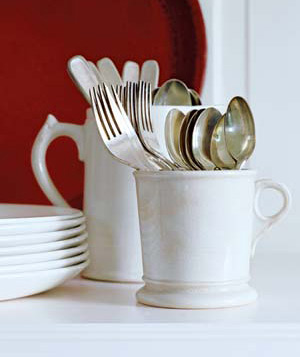 Silverware held in coffee mugs
