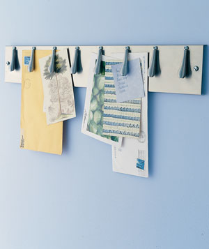Maintain order in your foyer in ways big and small. Here, a rack originally made for line cooks keeps shopping lists, to-do notes, and other see-it-before-you-leave papers under control.
