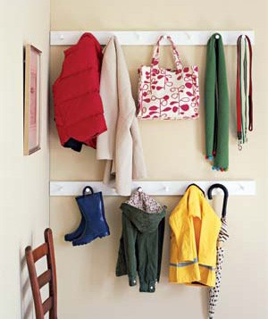 A row or two of pegs makes use of wall space and frees up the entryway floor and closet. A tote bag can hold winter gloves and hats.