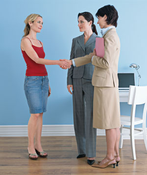 Underdressed woman shaking hands