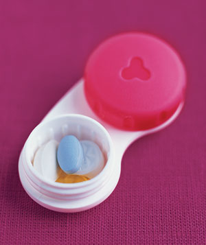 Pills stored in a contact lens case