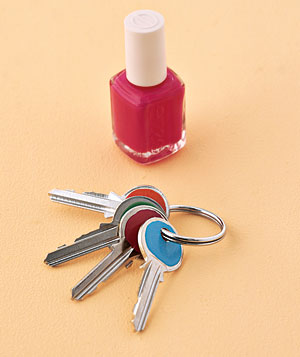 A bottle of nail polish and color-coded keys