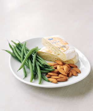 A plate of string beans, cheese and almonds