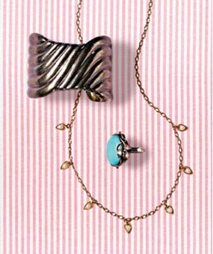 Jewelry on pink striped background
