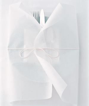 Place setting wrapped in parchment paper