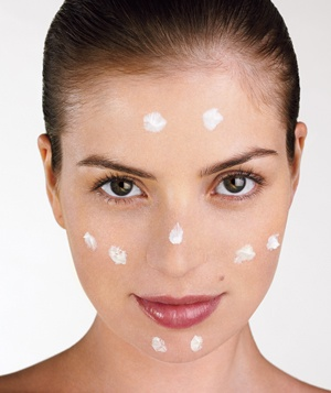woman with facial moisturizer