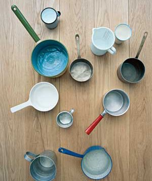 Sauce pans, pitchers and cups on the floor
