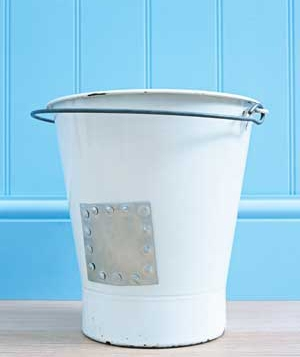 White bucket with a patch covering hole