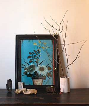 Framed painting and decorative objects