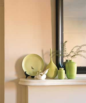 Green vases on a mantel