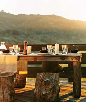 Table setting with food outdoors at sunset