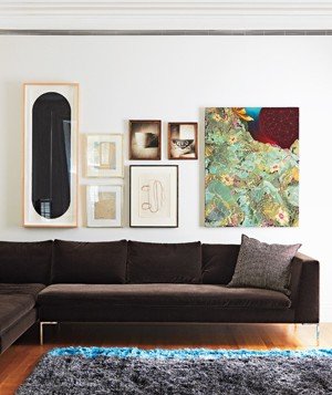 Pictures hanging above a couch