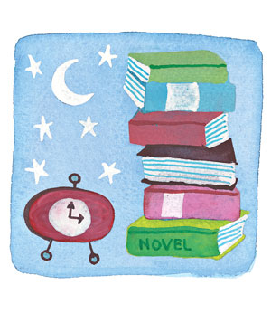 An alarm clock and a stack of novels