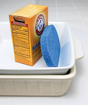 Arm & Hammer Baking Soda with a sponge