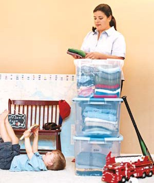 Woman and child organizing their home