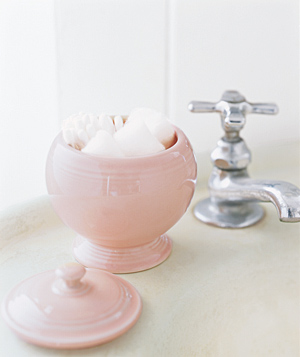 Think of an unused sugar bowl as a decorative container, perfect for cotton balls and Q-tips.