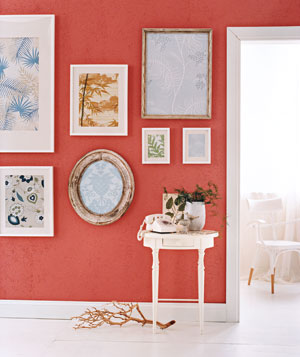 Engage visitors immediately by creating an eye-catching wall display. Here, unused pieces of wallpaper are framed eclectically.