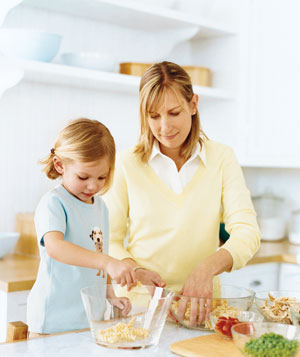 Woman and child preparing dinner