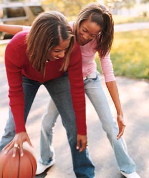 Mother and daughter playing basketball