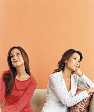 Two women sitting on a couch