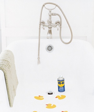 Decals in a bathtub and a can of WD-40