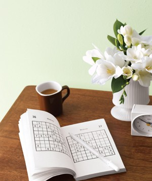 Sudoku puzzle and cup of coffee
