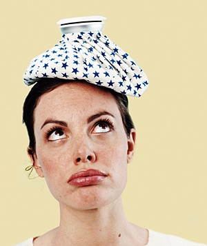 Woman with an ice pack on her head