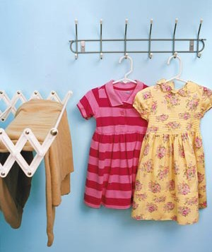 Create a clothes-hanging section in your laundry room with a wall-mounted drying rack that retracts when not in use.