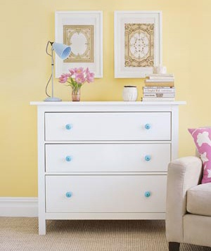 White dresser with blue knobs