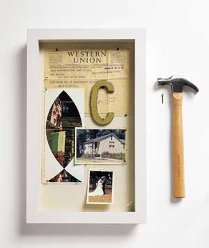 For a more pared-down version of the idea, try filling a series of shadow boxes with family memorabilia, such as report cards, photos, luggage tags, and postcards.