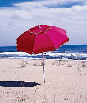 Red umbrella on a beach