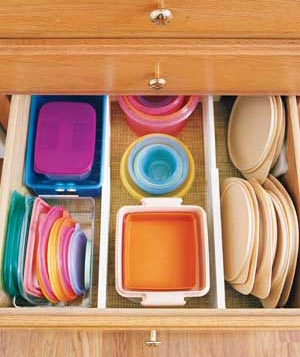 Plastic containers neatly stored in a drawer
