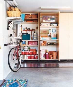 Even a garage that houses a lot of belongings can look clutter-free if you use shelves and hooks to keep things off the floor.