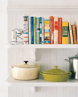 Cookbooks on a shelf with pots