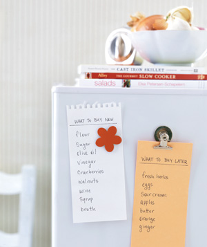 Shopping lists stuck on a refrigerator