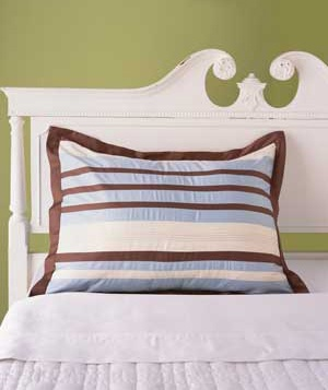 Striped pillow on a bed