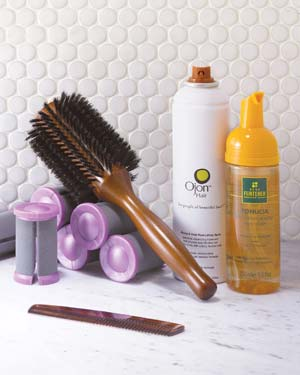 Round hair brush, curlers and styling products