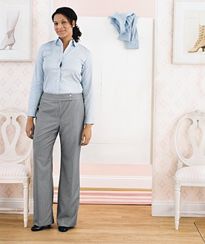 Woman wearing button-down shirt and trousers