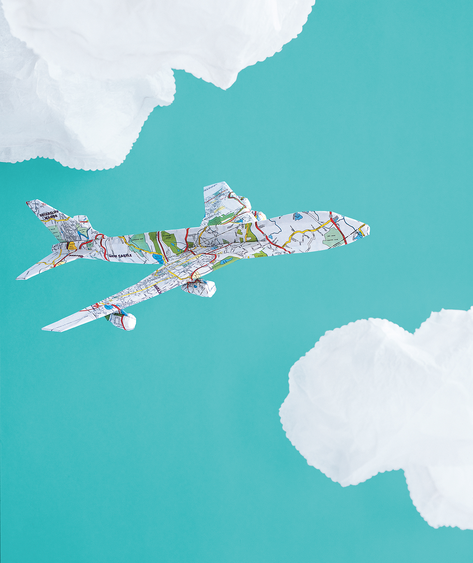 Paper construction of an airplane in clouds by Matthew Sporzynski