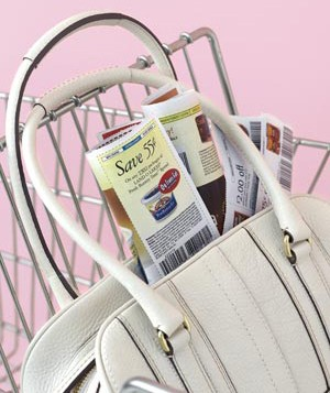 Handbag filled with coupons in a shopping cart