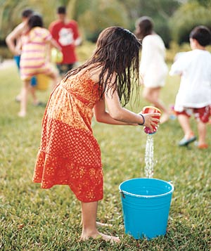 Little girl with a water bucket