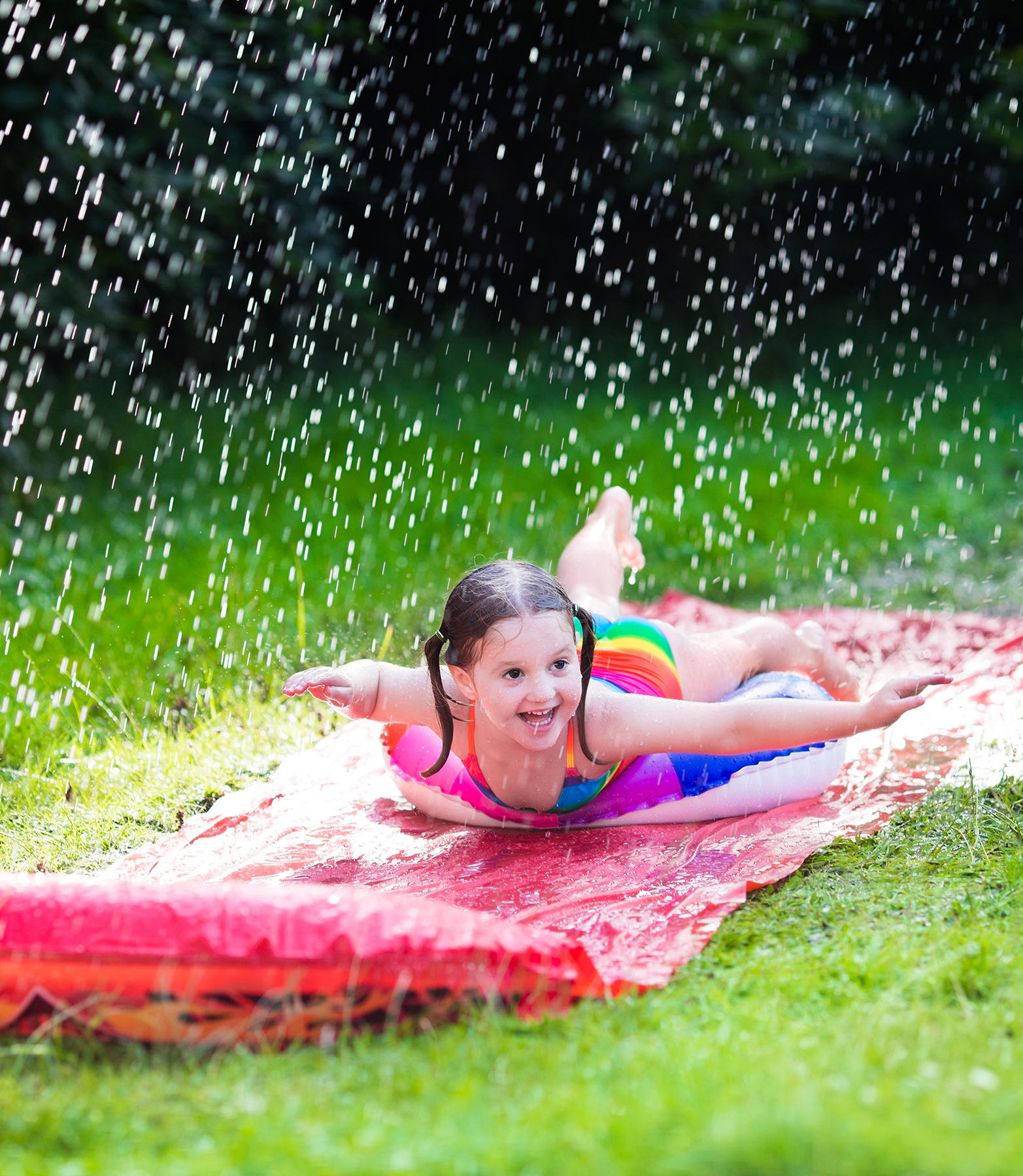 Kid playing on slip n slide