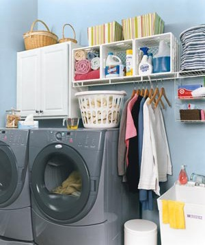 Simple milk crates break a long wire shelf into cubbies for organized laundry-room gear.