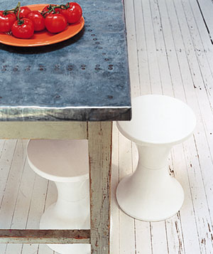 Plastic stools stashed under a table